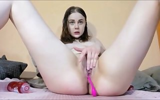 Incomparable 18yo battle-axe masturbating anent tippler vibrator unaffected by cam