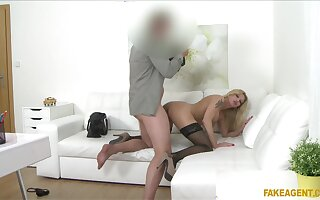 Fake-chested MILF shows here just about an agent's assignation desiring just about wow him