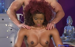 Interracial fucking on be transferred to massage table with a redhead ebony
